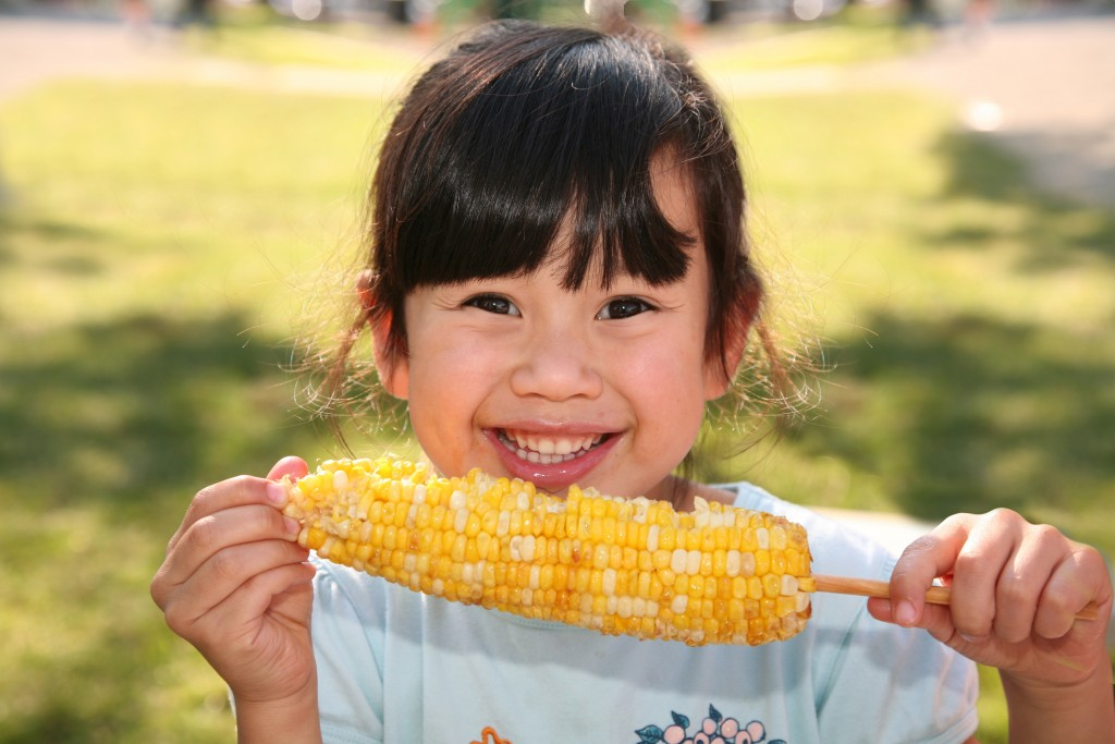 Girl eating corn